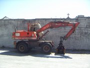 crane Minelli CM 140 with timber grapple